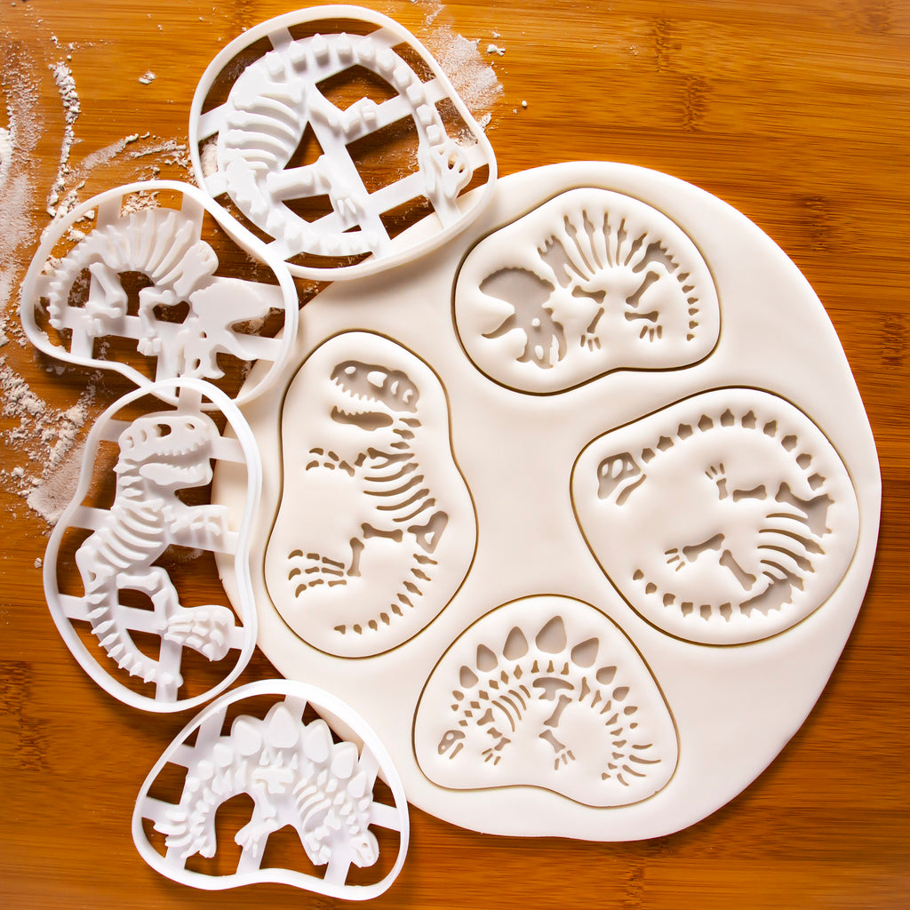 set of 4 dinosaur fossil cookie cutters, t-rex, stegosaurus, triceratops, long neck brachiosaurus