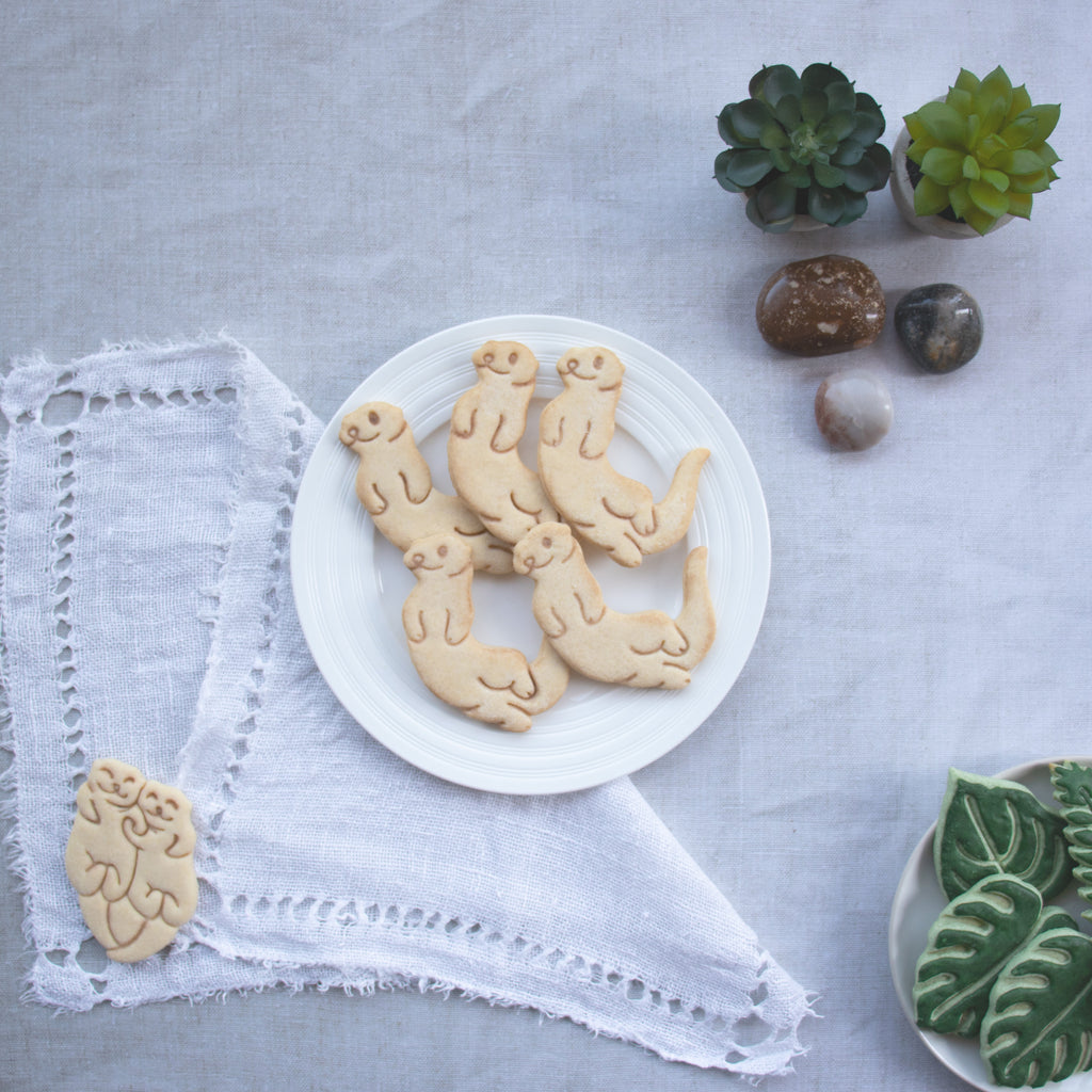 swimming sea otter cookies