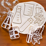set of 4 laboratory equipment cookie cutters: microscope, test tube, beaker, conical flask