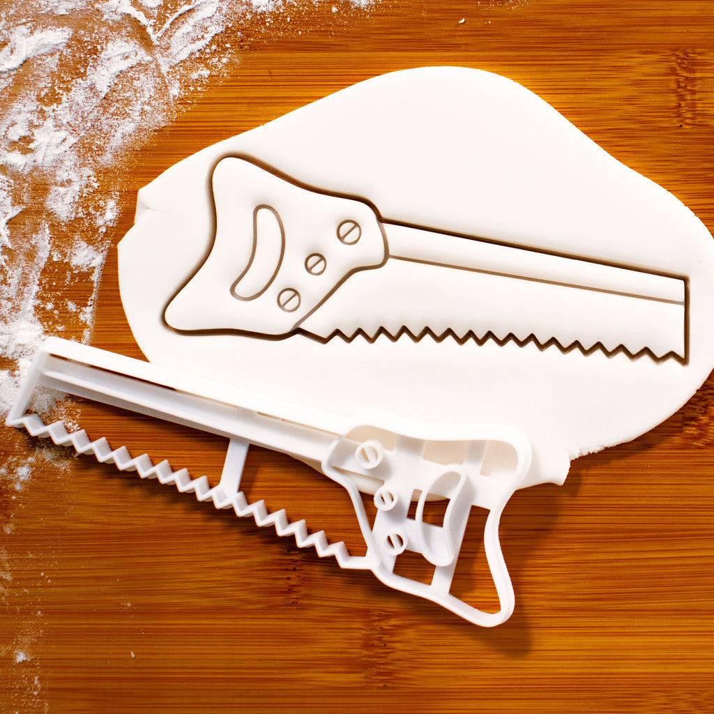hand saw cookie cutter pressed on fondant