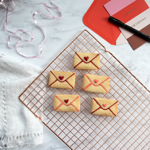 love letter envelope cookies on a tray