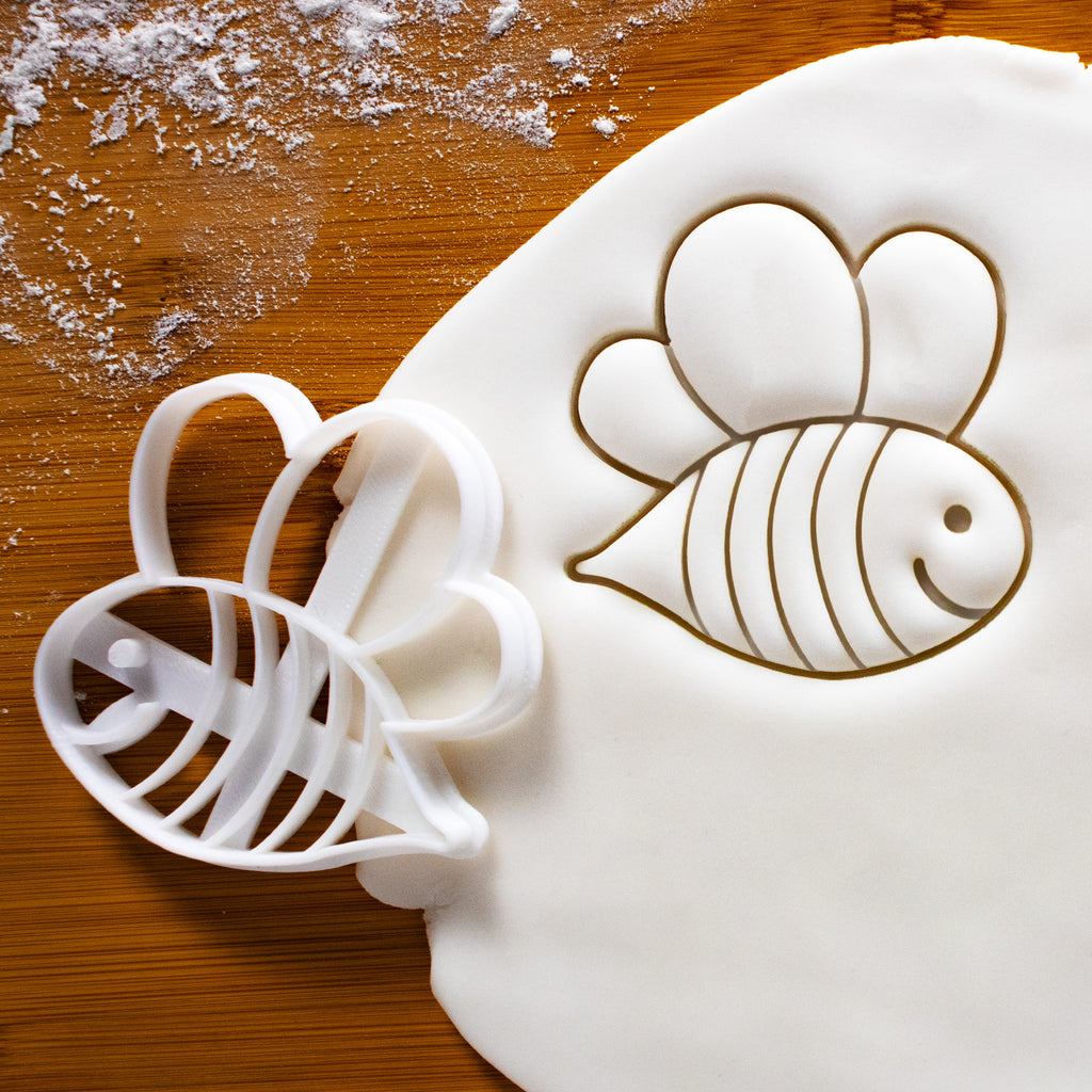 cute bee cookie cutter pressed on white fondant, perfect for baby shower