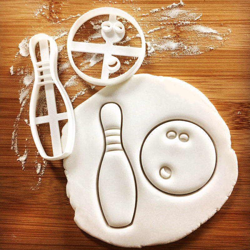 bowling pin and ball cookie cutters pressed on fondant