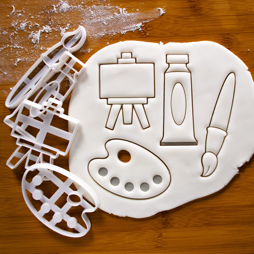 set of 4 artist accessories: featuring a palette, paintbrush, paint tube and easel stand cookie cutters
