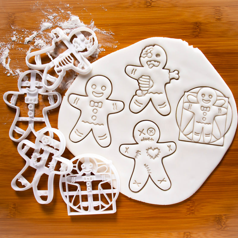 set of 4 cookie cutters, featuring a happy gingerbread man, a zombie gingerbread man, a vitruvian gingerbread man and a voodoo gingerbread man