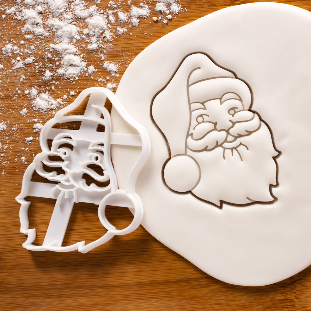 santa claus face cookie cutter pressed on white fondant