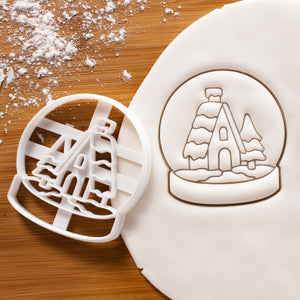 Snow globe cookie cutter pressed on white fondant
