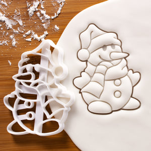 Snowman cookie cutter pressed on white fondant