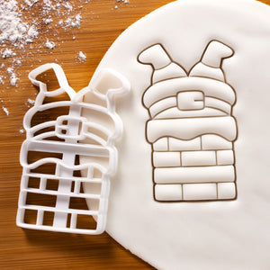 Santa Claus Stuck in the Chimney Cookie Cutter pressed on white fondant