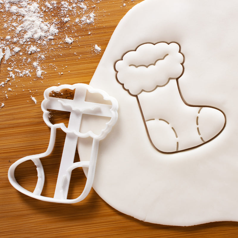 Christmas Stocking Cookie Cutter pressed on white fondant