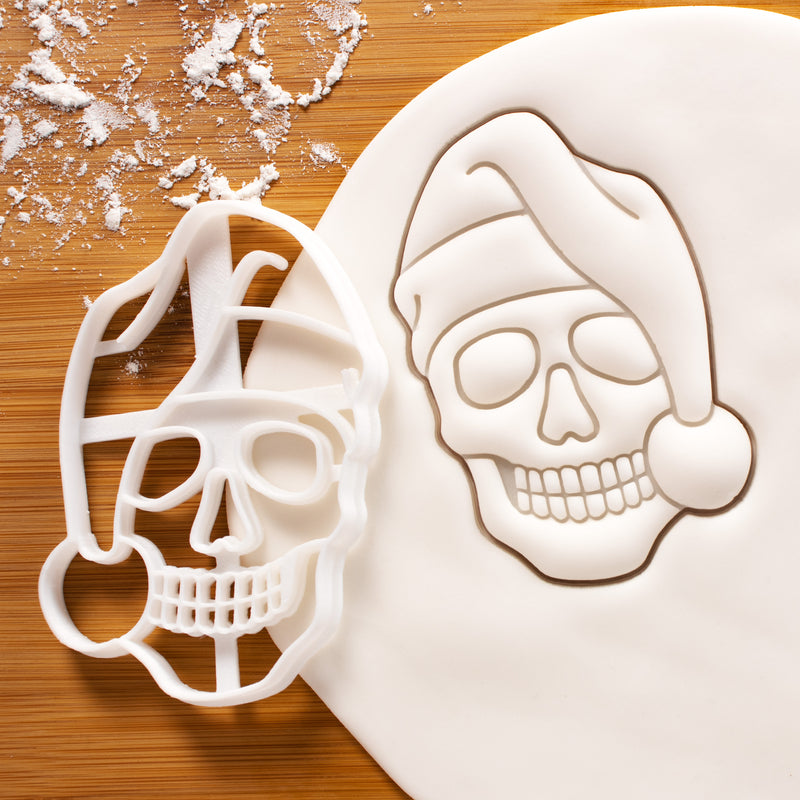 santa claus skull cookie cutter pressed on white fondant