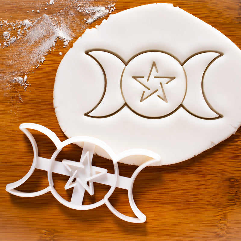 triple goddess cookies on a plate