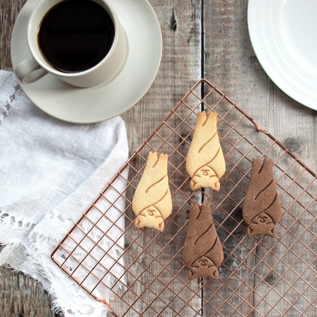 sleeping bat cookies on a tray