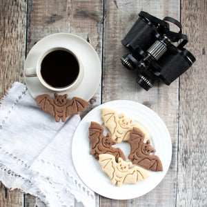 flying bat cookies on a plate