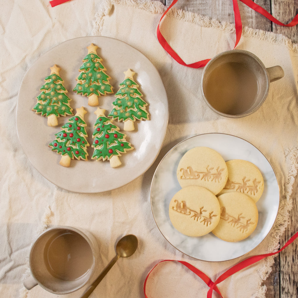 christmas tree and santa claus on reindeer sleigh cookies
