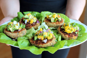 Spicy Chickpea Lentil Burgers topped with a sweet and delicious mango avocado Pico!