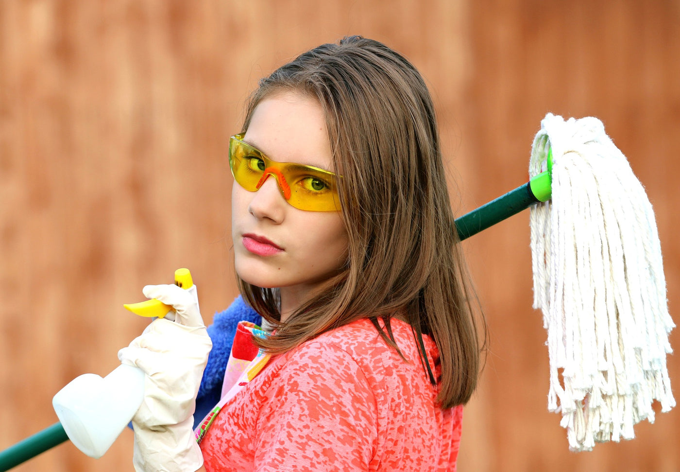 Girl with mop and cleaning fluid