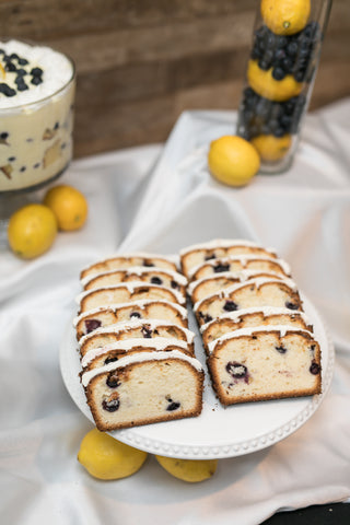 Blueberry lemon pound cake on white table cloth.