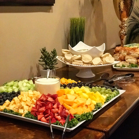 fruit tray, spinach and artichoke dip with french bread, and chicken salad sandwiches.
