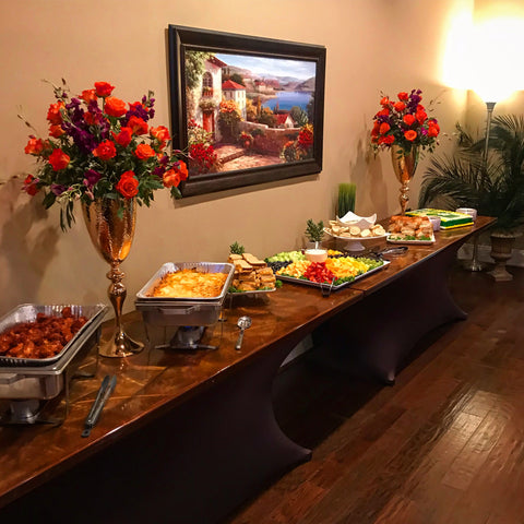 Buffet table with rose floral arrangements