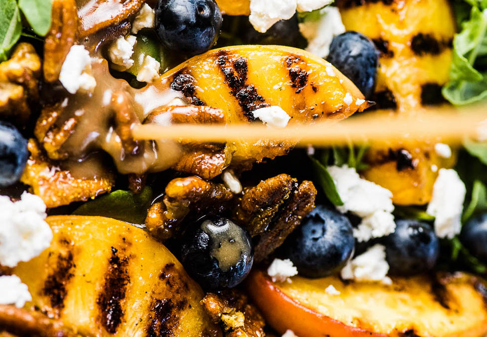 grilled peach salad with curry pecans and honey vinaigrette