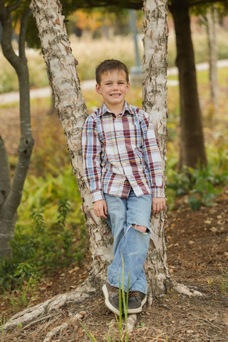 Photo of boy with legs crossed