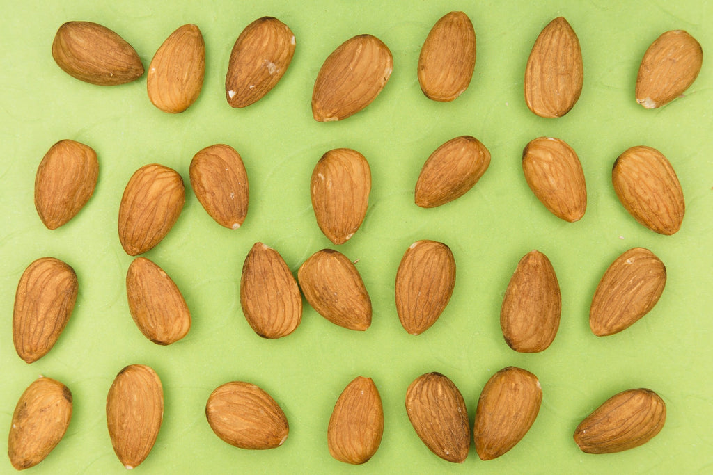 almonds on green background