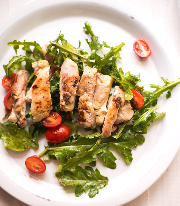 Grilled Chicken on bed of arugula with cherry tomatoes