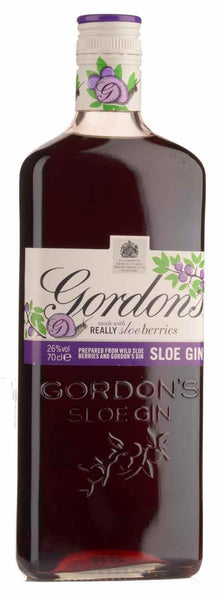 Classic style bottle with label stating the Gordon Sloe Gin spirit wine vintage by Diageo PLC from Scotland.