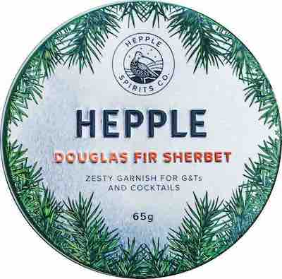Circular tin with tree pine label stating Hepple Douglas Fir Sherbet by Moorland Spirit, from Northumberland, England.