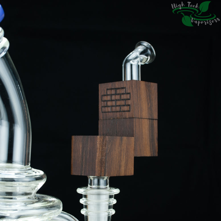 walnut flip brick vaporizer in use in glass rig