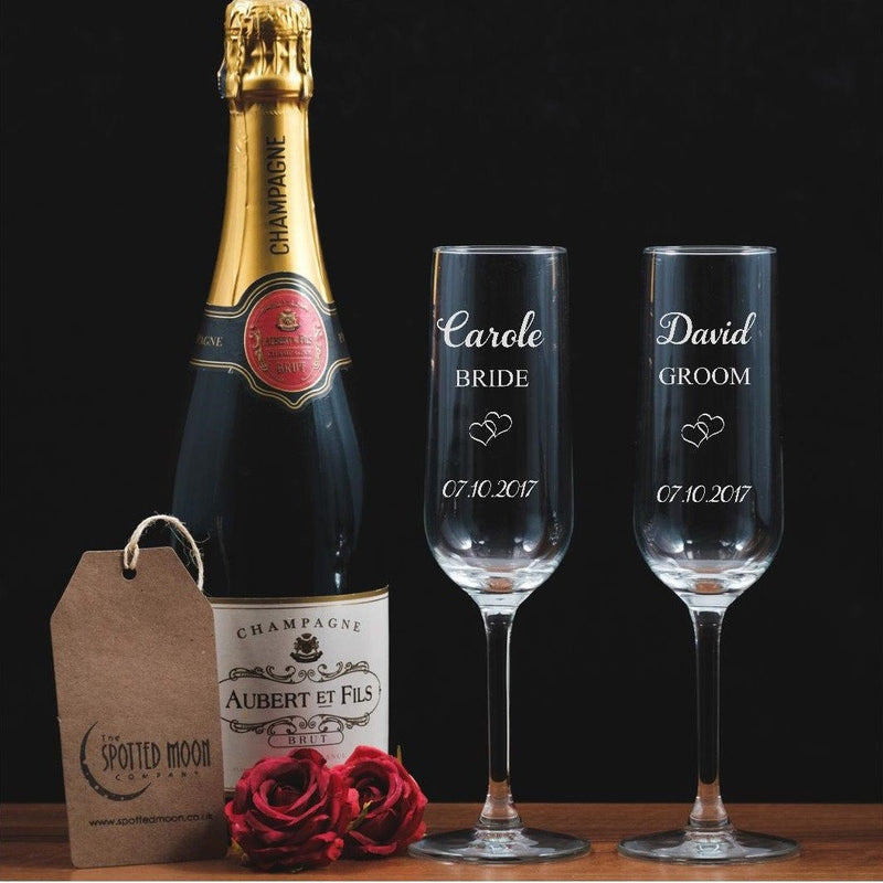 Two personalised engraved Bride & Groom glass Champagne Flutes - The Spotted Moon Company