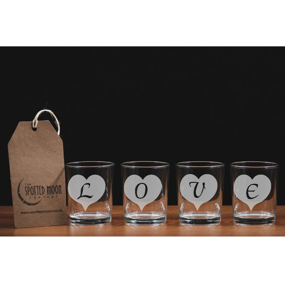 A set of four glass votive/tea light holders spelling LOVE - The Spotted Moon Company
