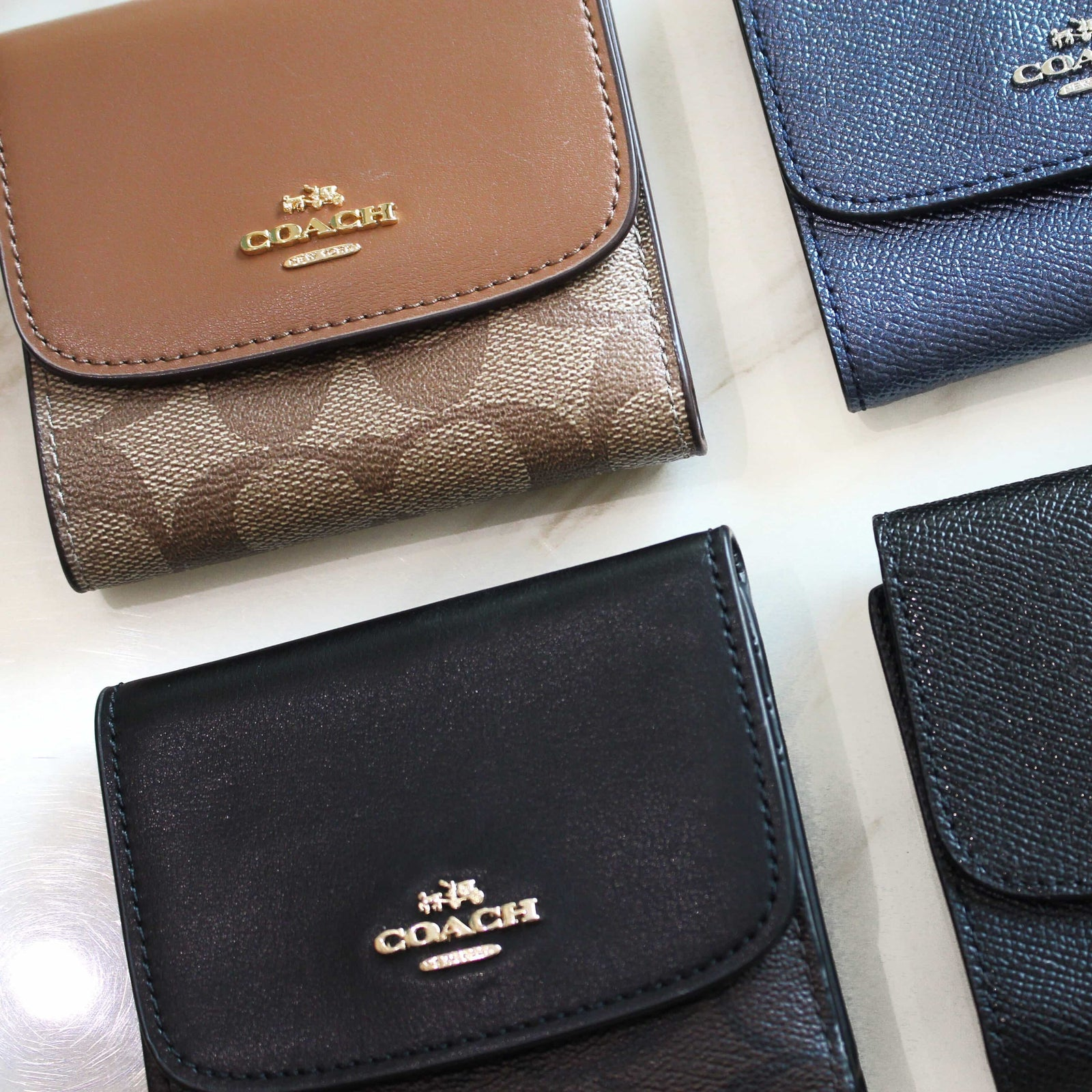 COACH SMALL WALLET IN SIGNATURE COATED CANVAS