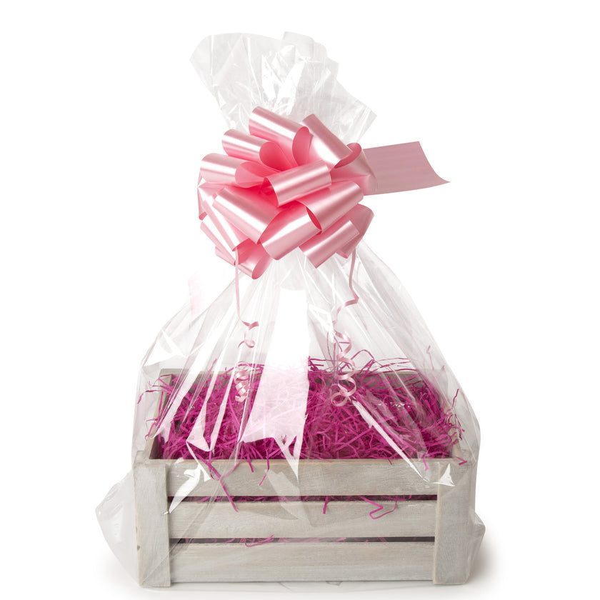 An image of a gift crate with bow, cellophane and shred