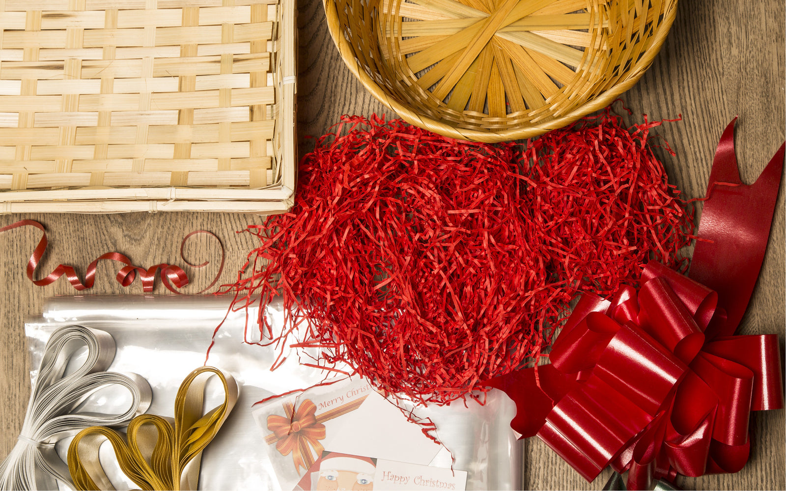 Image of gift baskets, shred, bows and gift cards