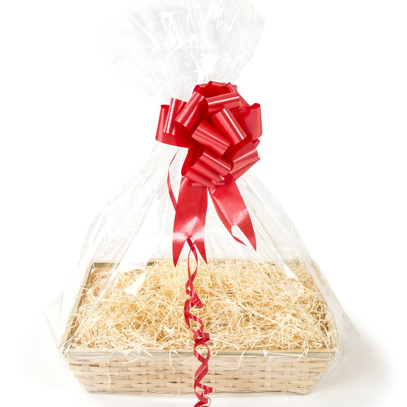An image containing a wicker gift tray with bow, shred and cellophane.