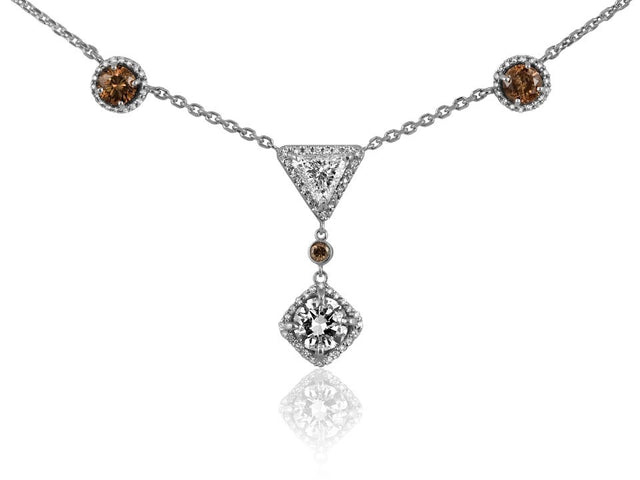 Necklace design by Ron George containing round, trillion and cognac diamonds.