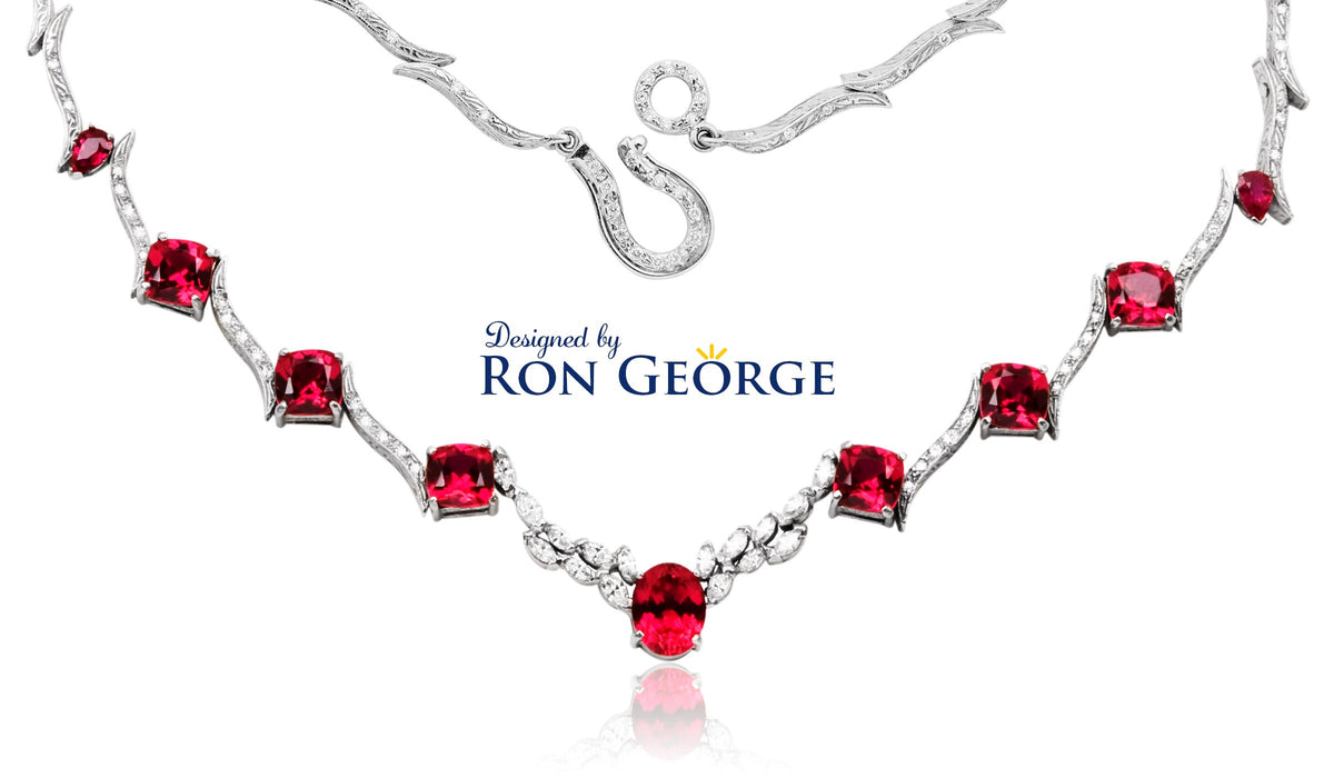 Custom designed necklace with engraved links and custom catch by designer Ron George.