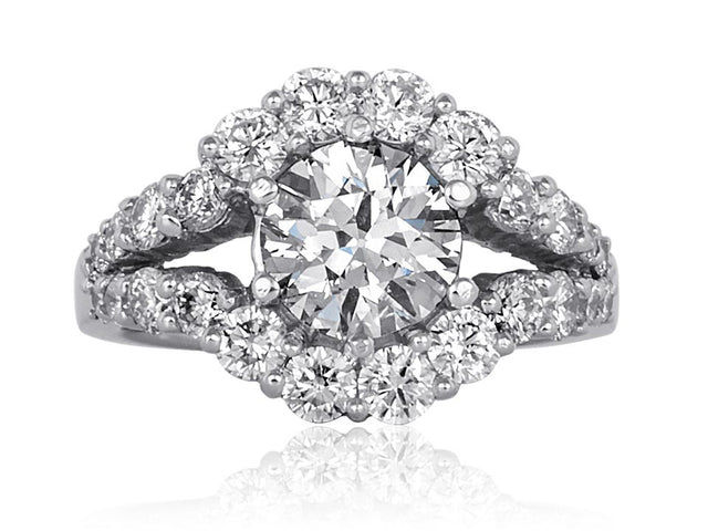 Diamond engagement ring with split band and halo designed by Ron George.