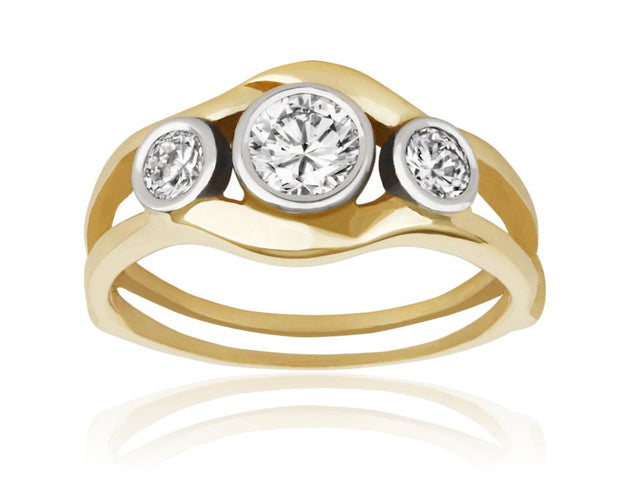 Three stone ring containing bezel set diamonds in two-tone gold designed by Ron George.