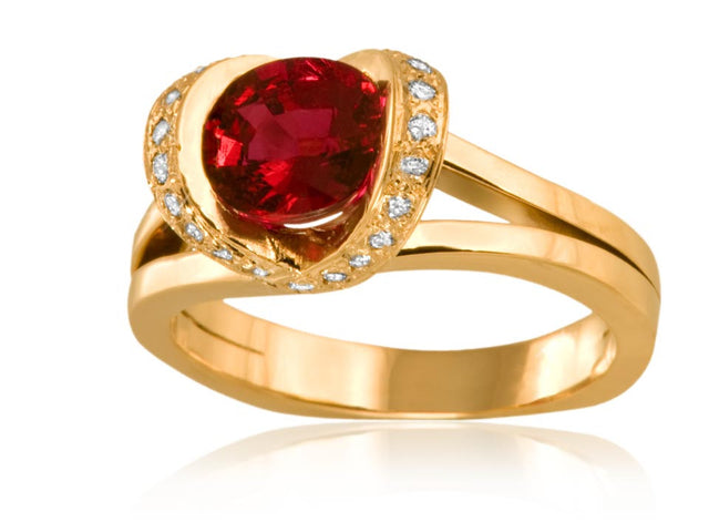 Ruby ring design by Ron George featuring a bow mounting in 18kt yellow gold.
