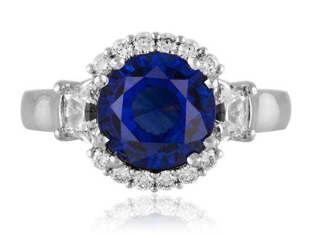 Ceylon sapphire ring with trapezoid side diamonds by designer Ron George.