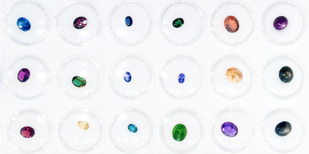 Loose selection of gemstones in multiple shapes and colors for sale and ready to set.