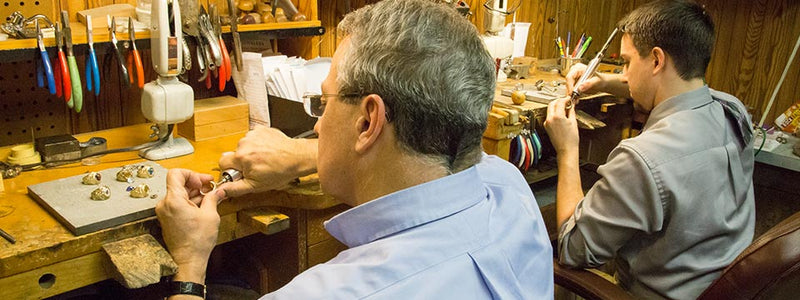 Ron and John George master goldsmiths working at the jewelers bench.