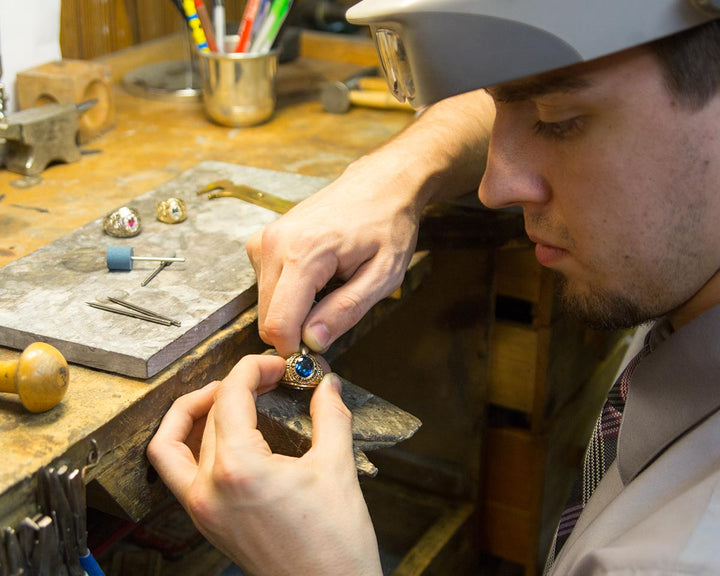 John working on a Canoe U package Naval Academy class ring.