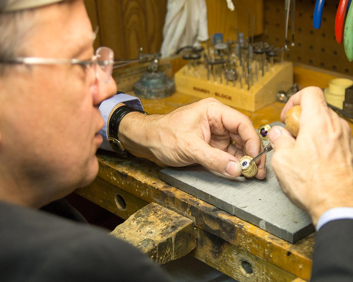 Ron working on an Elite package Naval Academy class ring at the bench.