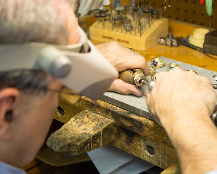 Ron cutting a seat for a gemstone.