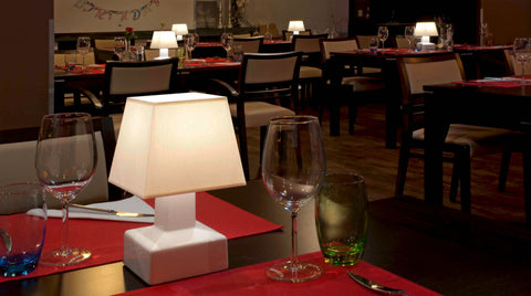 Compact battery table lamp in restaurant