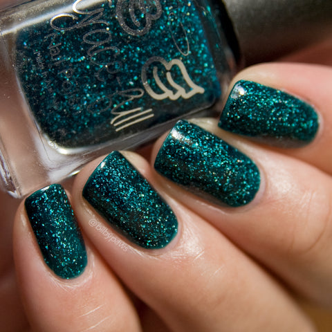 Evergreen Envy – a jelly teal coloured base with a smattering of holo flakes